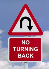 Signpost with 'No Turning Back' against a blue cloudy sky, business concept image.